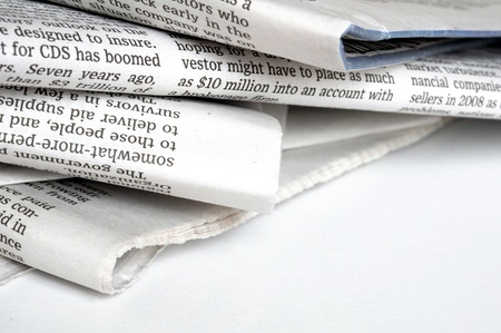 old newspaper: pile of old newspaper on a white background