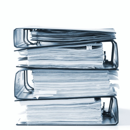 high stack of folders isolated on a white background Stock Photo