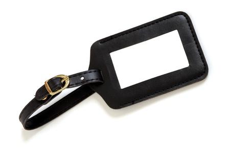 black leather suitcase label isolated on white background Standard-Bild