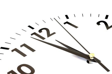 zeitarbeit: Uhr-Gesicht isoliert auf wei�em Hintergrund - Zeit-Konzept Lizenzfreie Bilder