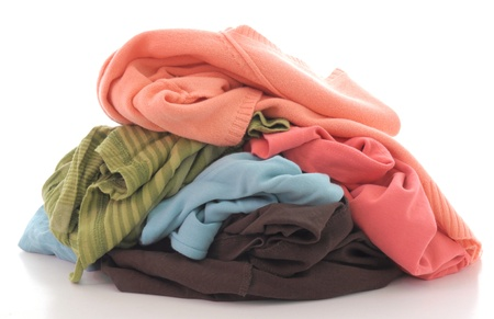 a pile of dirty clothing isolated on white background Standard-Bild