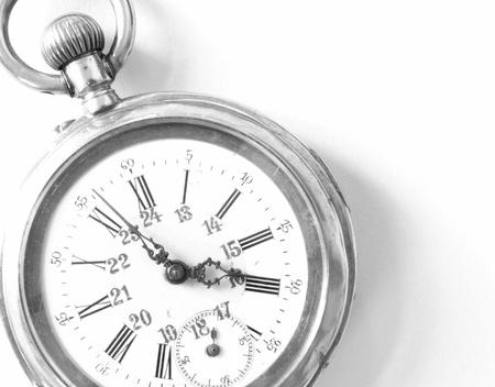 old pocket watch isolated on white background photo