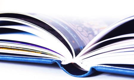 hardcovers: detail of a blue open book isolated on white background Stock Photo