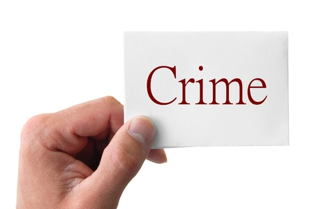 hand hold the word crime isolated on white background Stock Photo - 11030341