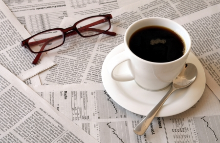 good morning cofffee break with reading the newspaper Foto de archivo