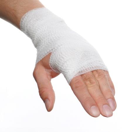 fractura: blanco vendaje medicina a la mano una lesi�n en el fondo blanco