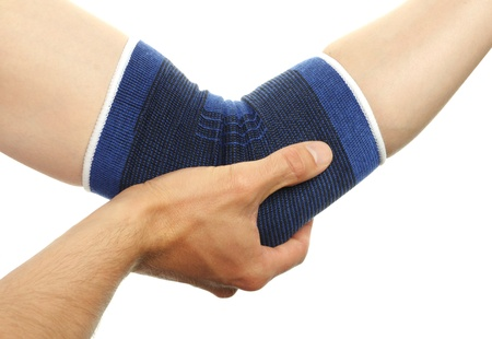 blue medicine bandage on injury elbow on white background photo