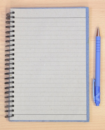 blank page from a notebook of a brown desk photo