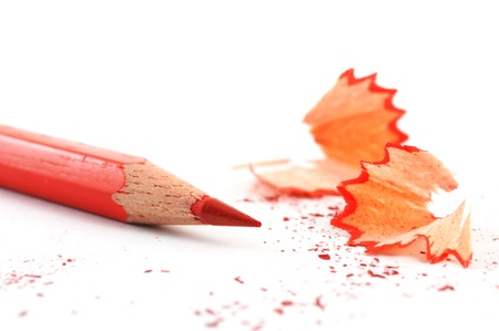 red pencil with shavings isolated on with background photo