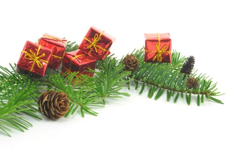 christmas decoration with branches, balls, presents and cone. isolated on white background Stock Photo