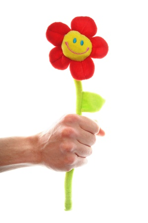 human hand hold a smiling flower, isolated on white backgound photo