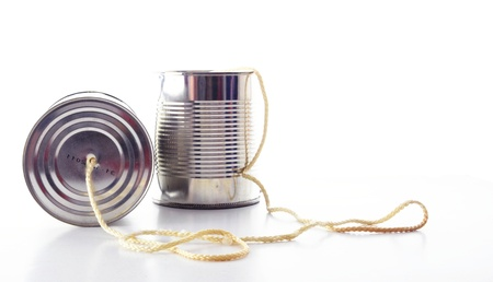 tin can phone: closeup of a tin cans phone isolated on white background, communication concept