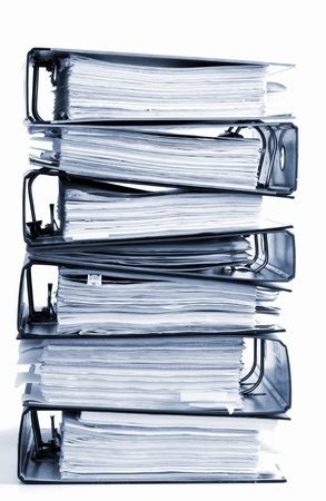 stack of documents: high stack of folders isolated on a white background Stock Photo