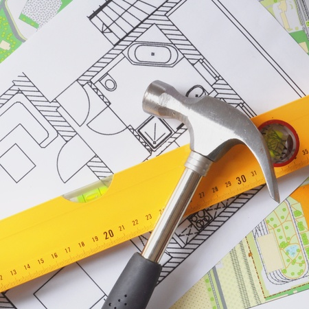 a modern building design with construction tools