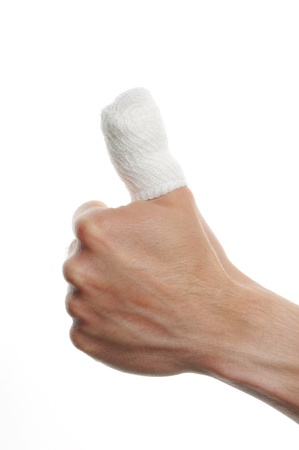 white medicine bandage on injury finger on white background photo