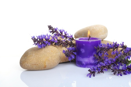 stone, candle and a bunch of lavender on white background photo