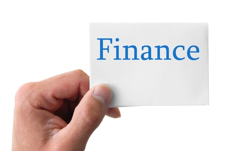 hand holding a card with the word finance Stock Photo - 11937953