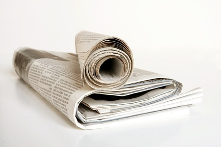 pile of old newspaper on a white background