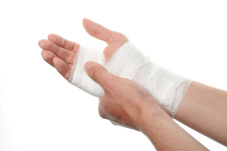 white medicine bandage on injury hand on white background photo