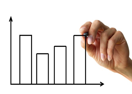 a human hand drawing a business chart isolated on a white background Stock Photo - 12622248