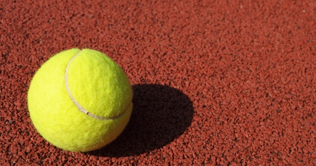 yellow tennis ball on the tennis court photo