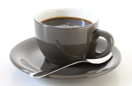 close up of brown coffee cup on whit background photo