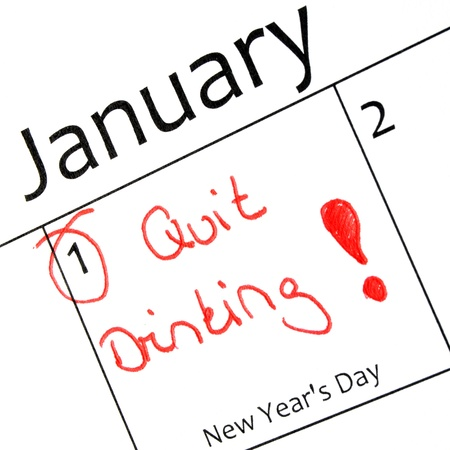 quit: new years resolution writing with a red pen in a calandar  Stock Photo