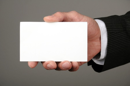 business man showing blank business card or sign Stock Photo - 13238837