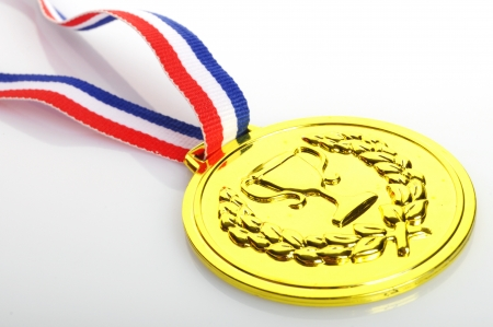 gold medal with ribbon on white background Stock Photo - 13634622