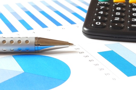 closeup of a business chart with pen and calculator  photo