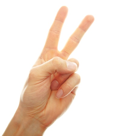 victory symbol: hand white peace sign isolated on white background