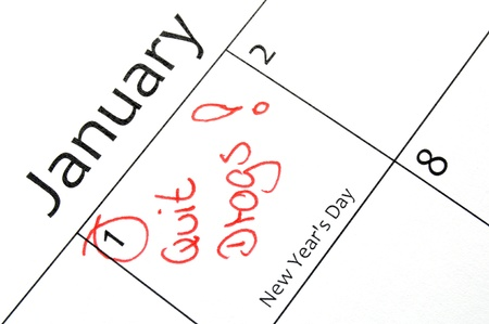 calandar: new years resolution writing with a red pen in a calandar  Stock Photo