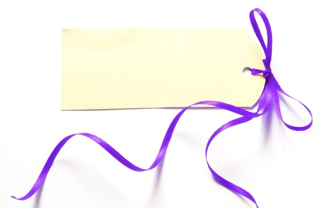 purple ribbon with label isolated on white background photo