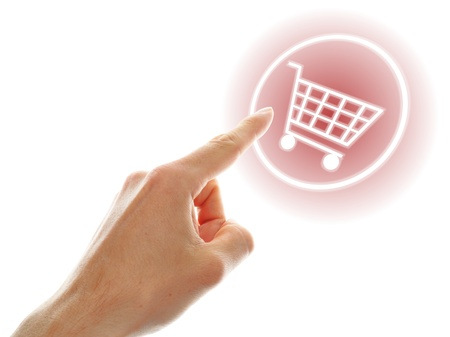shopping cart button presses by a male hand on white background Stock Photo - 13634568