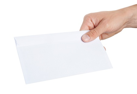 hand giving a blank envelope isolated on white background Stock Photo - 14180692