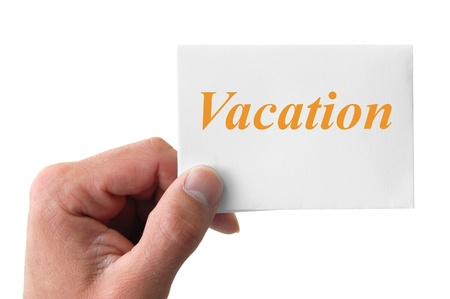 hand holding a card with the word vacation