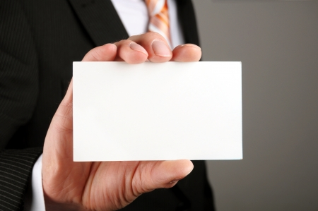business man showing blank business card or sign photo