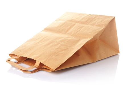 a brown used paper bag on white background photo