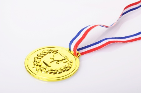 gold medal with ribbon on white background photo