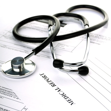 health insurance: Stethoscope with health insurance on a white background
