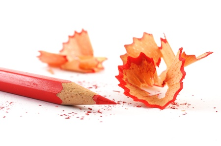 sharpener: red pencil with shavings isolated on with background