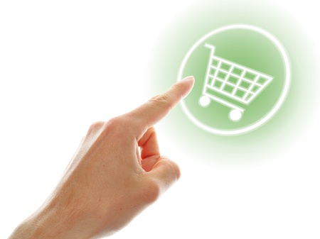 shopping cart button presses by a male hand on white background Stock Photo - 15174653