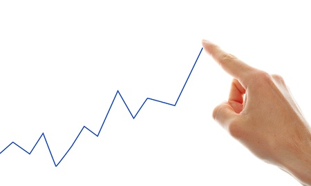 hand tracing a rising graph symbol for business growth Stock Photo