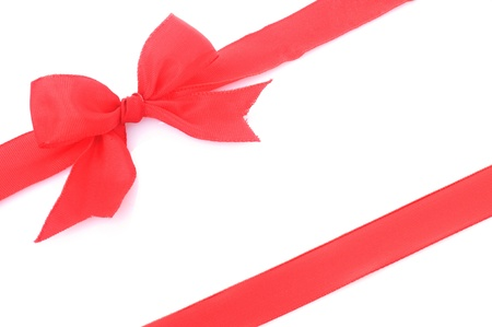 adorn: a red ribbon with bow on white background Stock Photo