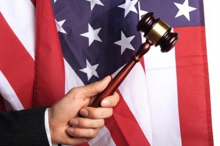 proceedings: american court, gavel in front of an american flag