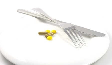 overbalance: a meal of diferent tablets with silverware
