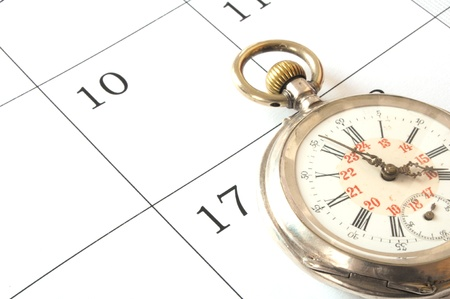 pocketwatch: a old pocket watch isolated on calendar