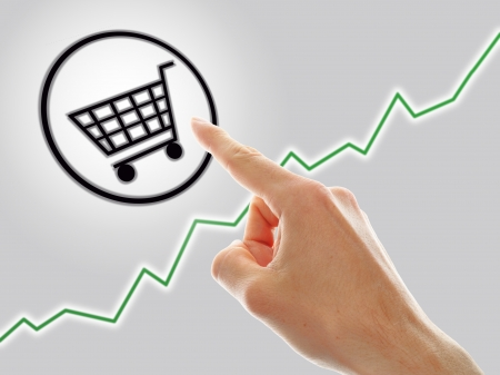 concept of growing e-commerce. shopping cart and graph Stock Photo - 15734439