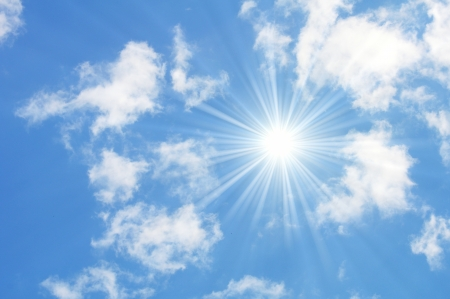 sunny blue sky with white fluffy clouds photo