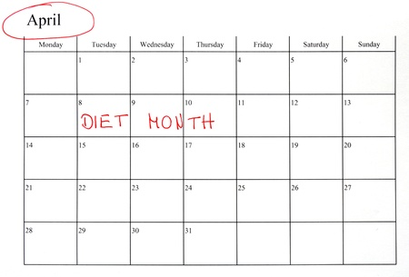 calendar marking the start of a diet in red letter stock photo